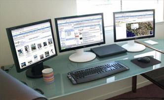 A three-monitor display setup