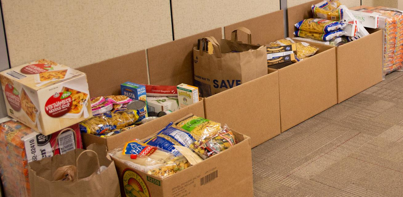 Boxes of food donated by Plugable and Efficient Era employees
