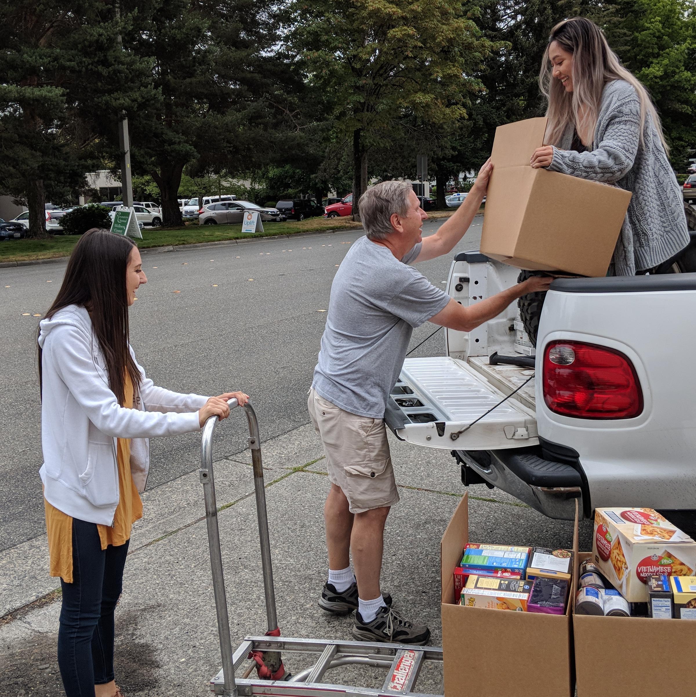 Unloading the donated food at the Renewal Food Bank