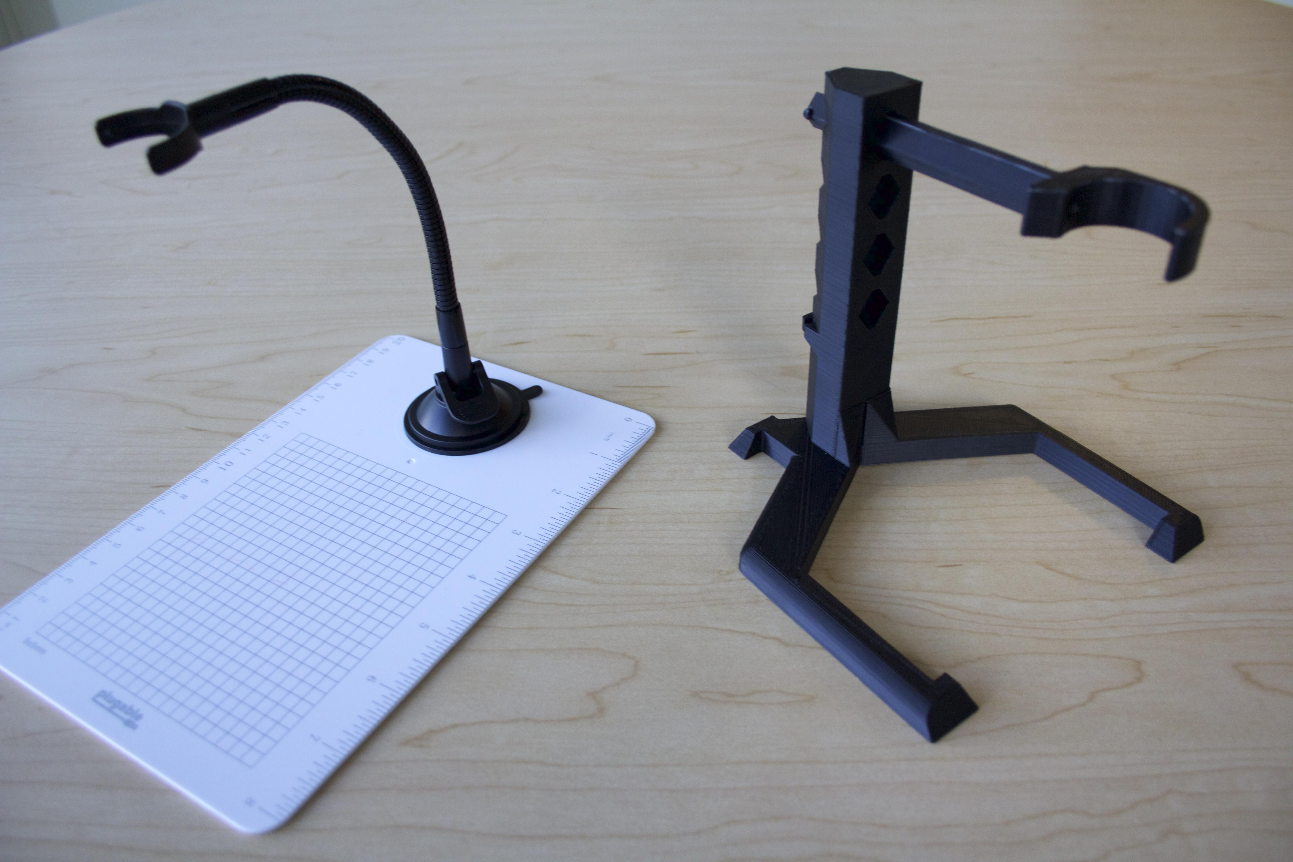 While the original stand for the microscope is flexible the new stand is more stable and rigid