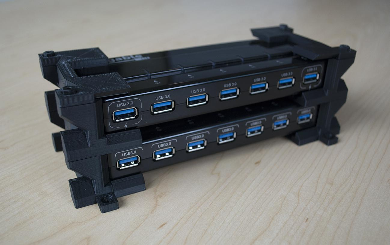 Two Plugable USB3-HUB7-81X hubs stacked together using a 3D-printed stand