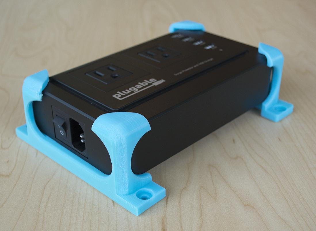 A 3D-printed mount on the Plugable PS2-USB4 powerstrip