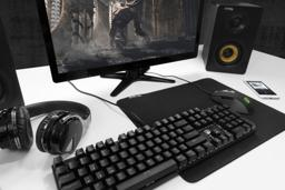 Lifestyle image showing gaming peripherals, including the mouse pad