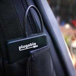 Image of the Plugable Solid State Drive fitting into a small pouch in a backpack
