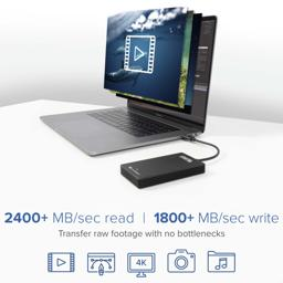 Thumbnail of Image of the Plugable Solid State Drive connected to a laptop and indicating fast transfer speeds