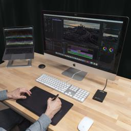 Image of a user using the Plugable Solid State Drive for their video editing work