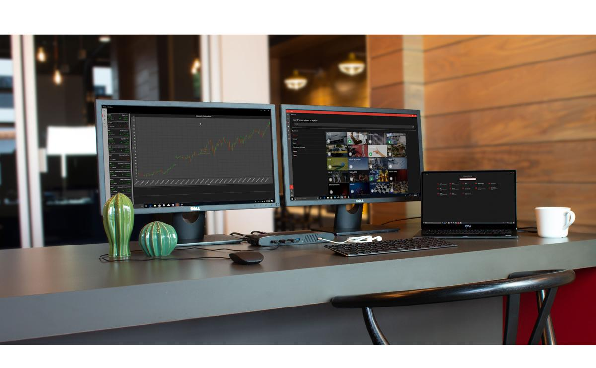 Lifestyle: UD-6950H on a desktop with laptop, two displays, and a keyboard