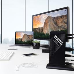 Thumbnail of Image of the Plugable USB-C Docking Station on its vertical stand, connecting a MacBook to a keyboard as well as a 4K display