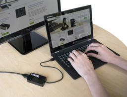Thumbnail of Image of Plugable's HDMI adapter in-use, connecting a laptop to an HDMI display
