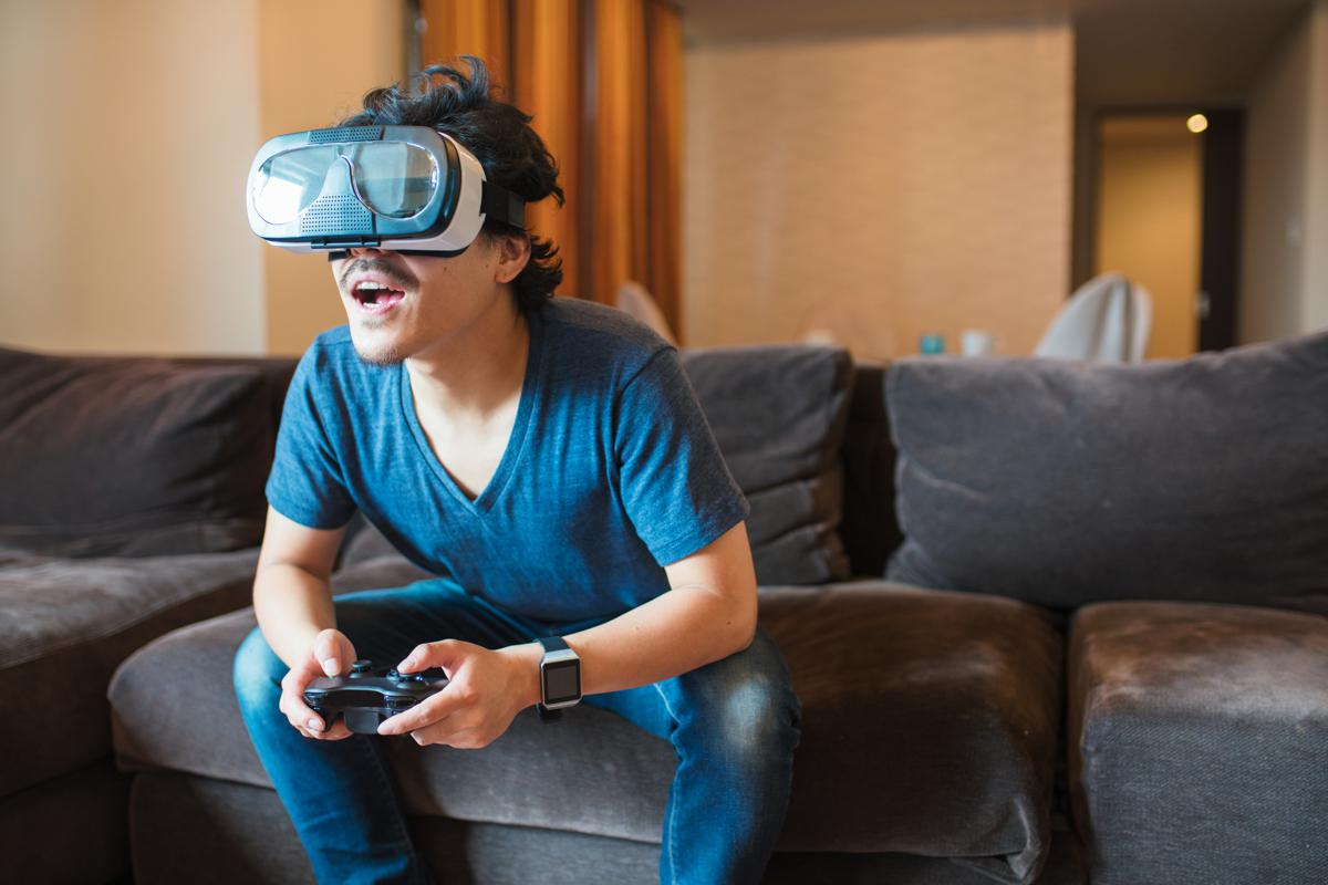 Man on couch wearing a VR headset