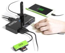 Thumbnail of Image of the Plugable USB Hub connecting in use, connected to multiple devices and charging a phone