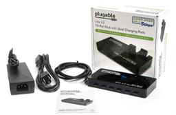 Thumbnail of Image of what's inside the box: a power adapter, the hub, and a cable to connect the hub to the host system, as well as a quick start guide